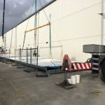 structural steel cantilever awning on ground about to be lifted by crane