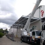 industrial cantilever awning for warehouse installed by crane