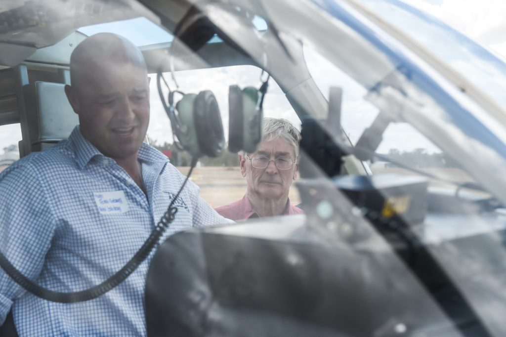 Hugh acton-adams with dick smith in helicopter