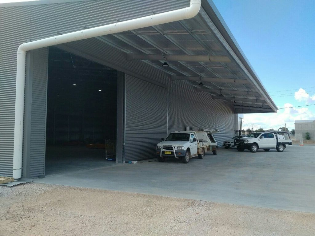 industrial warehouse with cantilever awning off side of shed
