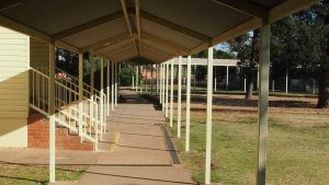 Underneath the covered walkway for Leeton school