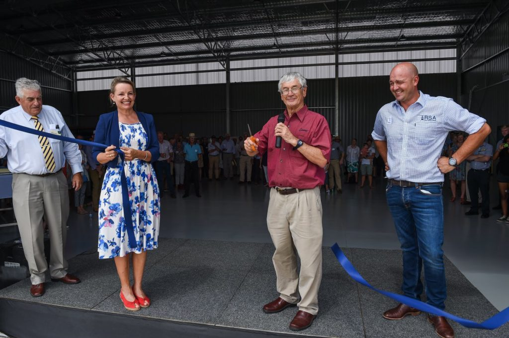 dick smith, susan ley and hugh acton-adams cut the ribbon at new helicopter hangar opening