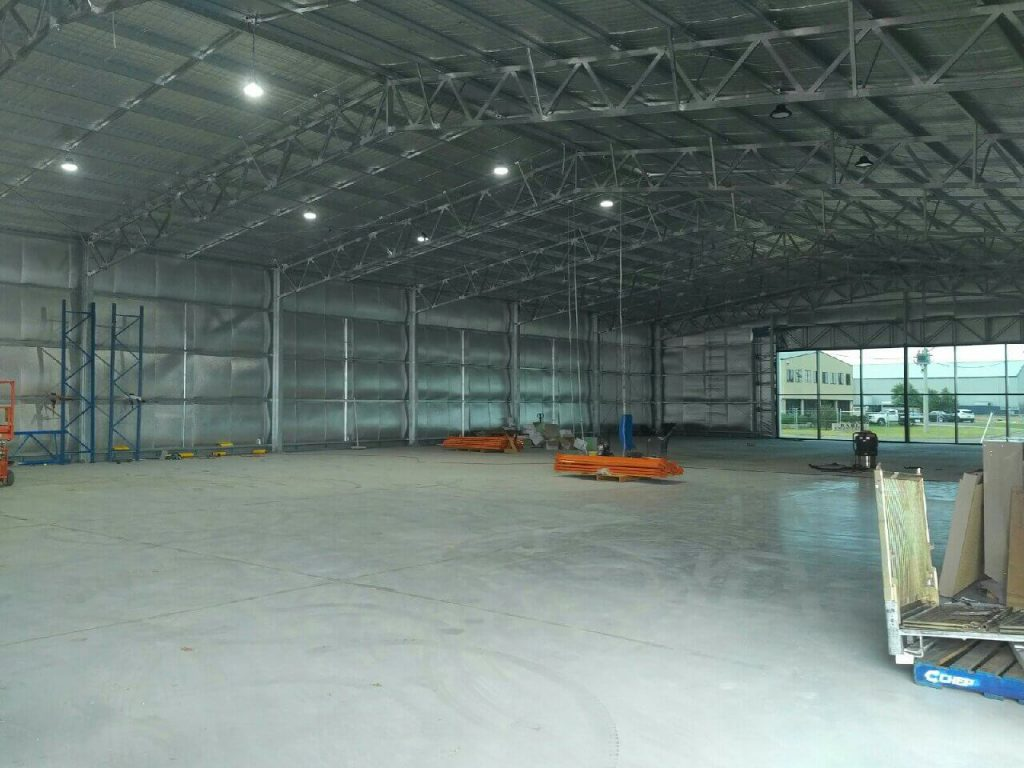 inside view of newly built industrial warehouse with web trusses structural steel construction