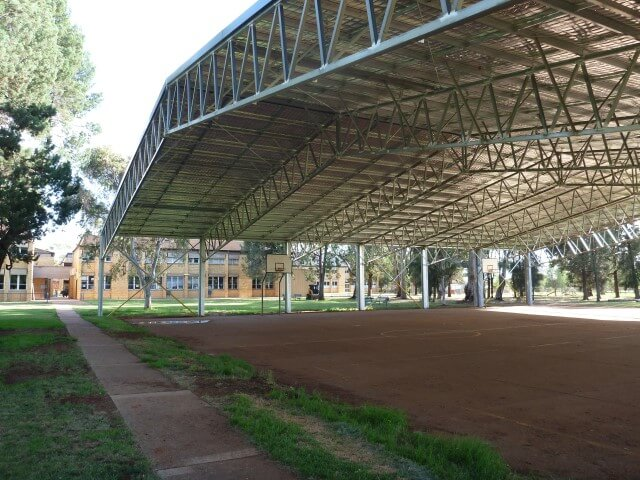 Side angle view of covered outdoor basketball court