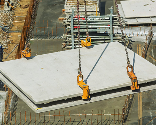 Concrete panels being moved into place by crane