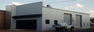 Closeup of industrial storage building with front offices