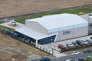 Birdseye view of large industrial shed and aircraft hangar