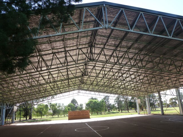 Under the covered outdoor basketball court for Wade highschool